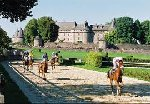 Horse racing by a castle